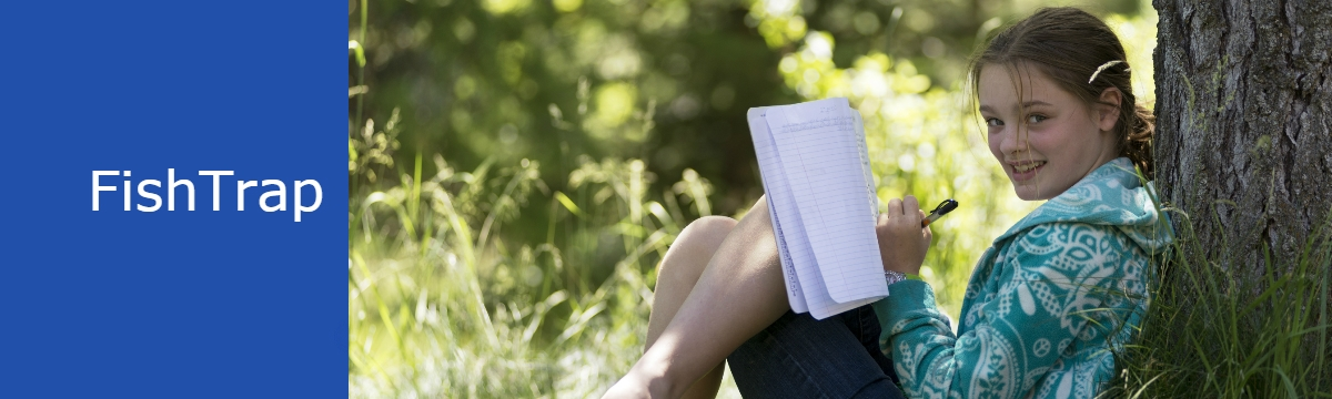 A young girl with Fish Trap leans against a tree writing in a journal