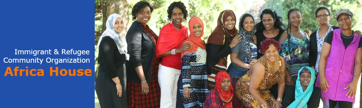 A group of African women stand together looking at the camera